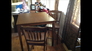 Pub style table and 4 arrow back chairs