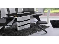 Acrtic Black Glass and White High Gloss Dining table. Extending function with 6 chairs