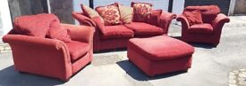 Red DFS sofa with 2 chairs and foot stool