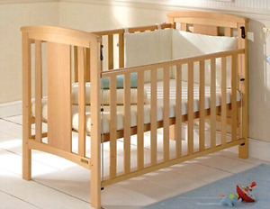 Baby crib bed solid hard wood in great condition with custom roc