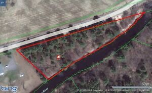 1.7 acre wooded lot fronting 675` on Kashe river in Muskoka