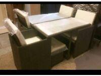 A brand new grey cube 9 piece garden rattan furniture set .