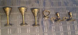 Brass candle holders and decorations.