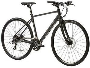 Opus Orpheo road bike and magnetic stationary trainer