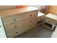 chest of drowers with two bedside tables