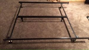 Queen bed frame with a center bar, adjustable, on wheels