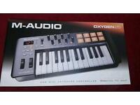 m-audio oxygen 25 usb midi keyboard controller.