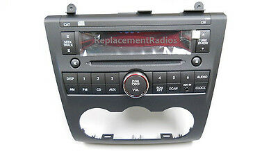 (Altima CD radio + front aux input jack. OEM factory original stereo. NEW in box!)