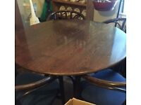 Dark wood round dining table with 4 bamboo style dining chairs