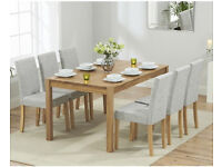 BRAND NEW, STILL IN BOX. 150cm Solid Oak Dining Table with 8 Grey Fabric Chairs