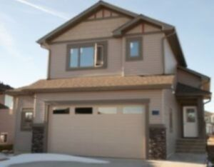 OVER 35 CHESTERMERE HOUSES UNDER $550k WITH FRONT GARAGES
