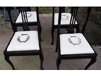 Set of four wooden vintage dining chairs with updated seat pads with a fox and wreath design