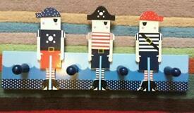 Gisela Graham Nautical pirate wood clothes hooks.