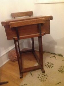 Antique school desk with ceramic ink well