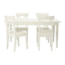 Solid white wood extendable dining table and 6 chairs