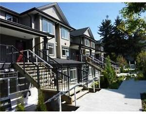 Luxurious New Townhouse 1 bedroom + den (7428 14th Avenue, Burna