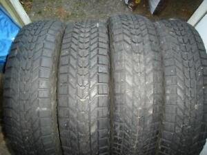 SET OF FOUR 215/75R15 WINTER TIRES IN GOOD SHAPE GOING CHEAP