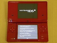 new red nintendo dsi with 11 games (