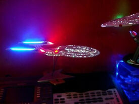 uss enterprise and voyager with lights