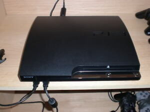 ps3 slim works perfect + 2 controllers
