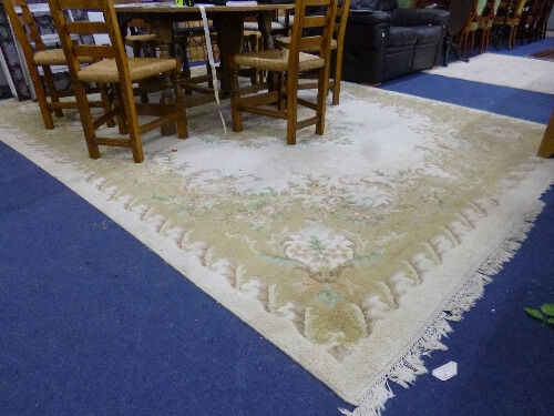 A LARGE INDIAN CREAM AND BEIGE 100% WOOL CARPET, hand knotted in India, label