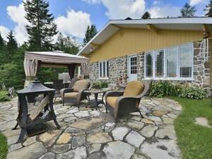 charming stone faced country home with pool, small lake & river