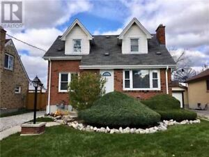 Wonderfully Renovated Red Brick Home with Stunning Curb Appeal!!