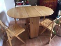 Compact fold away table & 4 chairs. Chairs are stored inside table