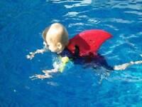Shark fin swimming float