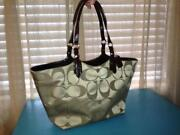 Coach Signature Carly Handbag