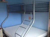 triple bunk bed frame wih double bed on bottom and single bed on the top