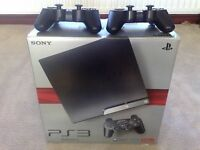 Slim PS3 with 2 controllers and games