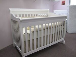 White solid wood convertible crib