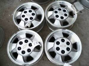 gm tahoe 16 inch x 7 inch aluminum rims with center caps 6-5 1/2
