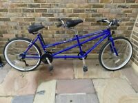 Tandem bicycle with pump and front carry bag