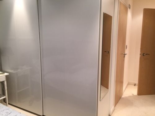 ikea white pax wardrobe and 2 hasvik high gloss sliding. Black Bedroom Furniture Sets. Home Design Ideas
