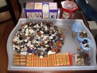 A large selection of vintage buttons, tins and old stuff