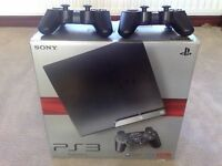 PS3 Slim with 2 controllers and games