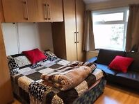 A large bright double room situated in Cranford. All bills included. Fully furnished.
