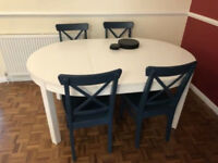 Extending table with 4 chairs