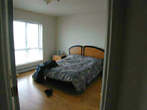 Master bedroom to rent/condo  sharing brossard water front