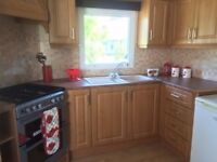 cheap static caravan for sale on newquay holiday park in cornwall. all fees included