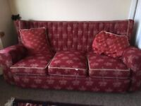 Dark red three piece suite, 3 seater sofa and two armchairs