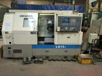 OKUMA MODEL LB 15 - 2 AXIS CNC LATHE YEAR 1994