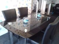Harvey's Boat shaped rectangle black and clear glass chrome dining table