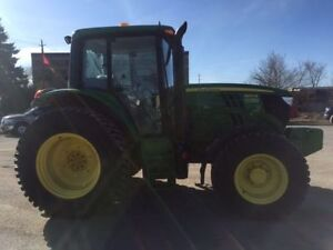 Rent a 85-125hp tractor for $5000 per season