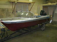 REDUCED PRICE boat motor and trailer