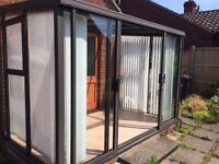 Used Conservatory - Aluminium/Dark Mahogany UPVC, with Glass Panelling and Roof