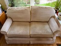Sofa for sale - two seater, pre-loved, soft honey-gold coloured with piping. Slimline profile.