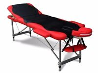 Gorgeous red & black portable massage table with all accessories and carry case. Only used 3 times.